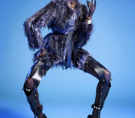 Mari @ MUSE wears Fur Coat & Belt / Adrienne Landau Earrings / Dolce & Gabbana Harness Necklace / LARUICCI Right Arm Cuffs / LARUICCI, Volu Left hand Ring / Volu Leather Tight Highs / Viktor Luna Shoes / Brian Atwood