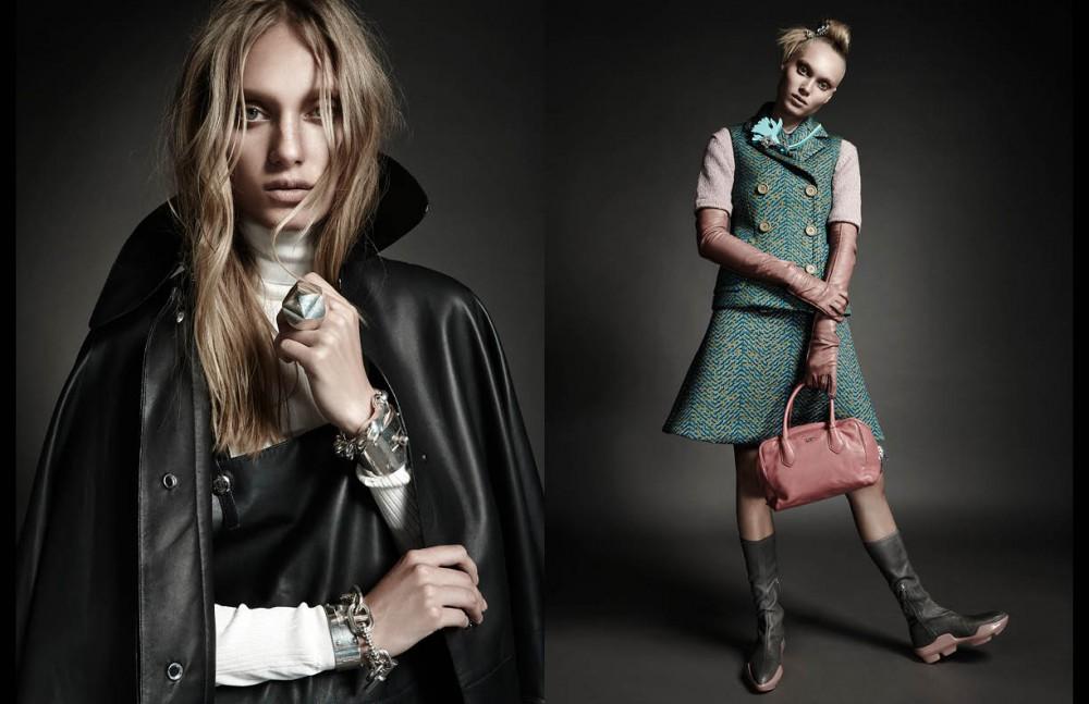 Jumper, overalls, oversized coat, bracelets & ring / Hermès Opposite Shirt, jumper, vest, skirt, brooch, gloves, bag, boots and barrette / Prada