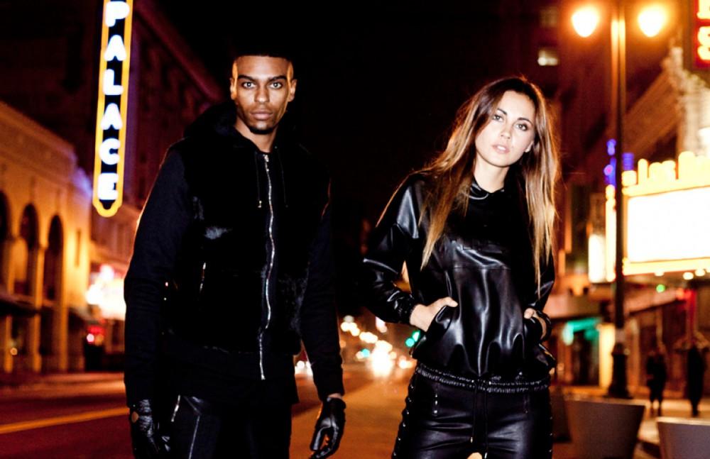 Deangelo wears Manière De Voir Fur Panel Hooded Jacket Snake Embossed Gloves Ribbed Knee Leather-Effect Trouser Ana wears Manière De Voir Leather-Effect Hooded Top Leather-Effect Tie-Side Trouser