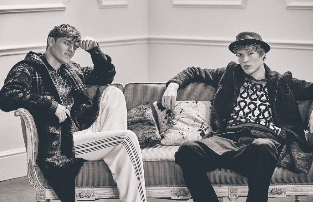 Alex wears Coat / Emporio Armani Jacket & trousers / LOEWE Jumper underneath / rag & bone Sven wears Coat / Harris Wharf London Jumper & trousers / Vivienne Westwood MAN Hat / Kangol Sunglasses / Cerruti 1881